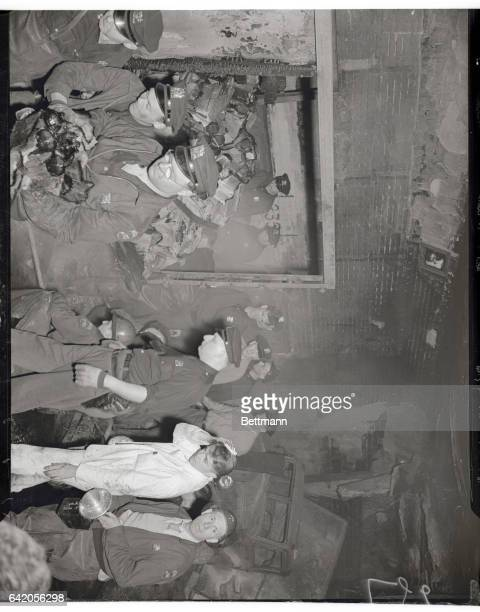Aftermath of Gas Explosion in Holland Tunnel New York Police and fireman are shown looking over wreckage left inside the Holland Tunnel after the...