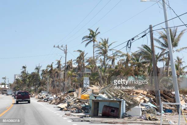 aftermath of hurricane in florida keys leaves piles of trash and debris to be cleaned up - emergencies and disasters stock pictures, royalty-free photos & images