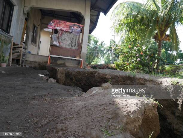 Aftermath of Taal volcano eruption large earth fissures caused the destruction of concrete houses in Barangay San Teodoro threatening people and...