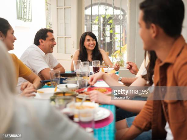 after-meal conversation of mexican family - nosotroscollection stock pictures, royalty-free photos & images