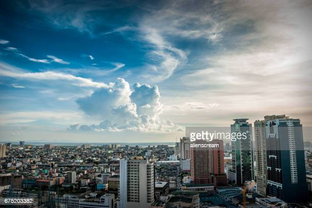 afternoon clouds - makati stock photos and pictures