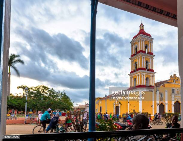 Afternoon lifestyle in the center of the colonial village The main Catholic Church Saint John the Baptist is in the background The image is framed...