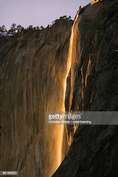 afternoon light on horsetail falls, a phenomenon that occurs once or twice a year in late february due to the angle of the sun and snow melt on the cliffs, yosemite valley, yosemite national park, unesco world heritage site, california, united states of am - light natural phenomenon stock pictures, royalty-free photos & images