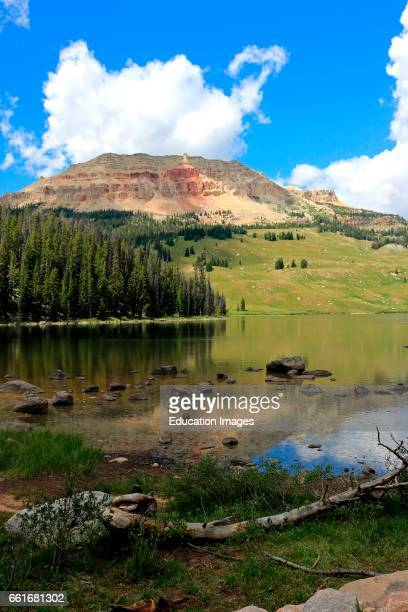 Afternoon reflections of Bear tooth Butte in the calm waters of Bear tooth Lake in the Shoshone National Forest in Wyoming along the scenic Bear...