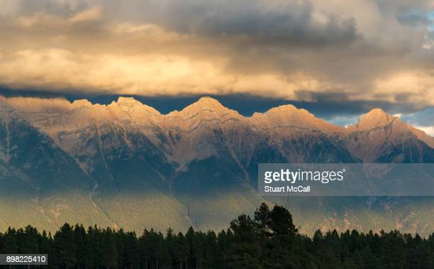 Afternoon sunlight hitting the tops of mountain range in Southern BC