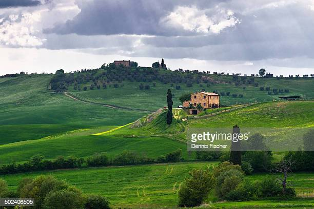 Afternoon sunrays through cloudy skies in the Tuscany.