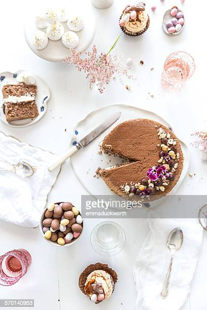 Afternoon tea with chocolate sponge cake and easter eggs