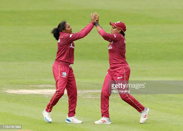 Afy Fletcher of West Indies celebrates with team mate Chedean Nation after taking the wicket of Tammy Beaumont of England lbw during the 2nd Royal...