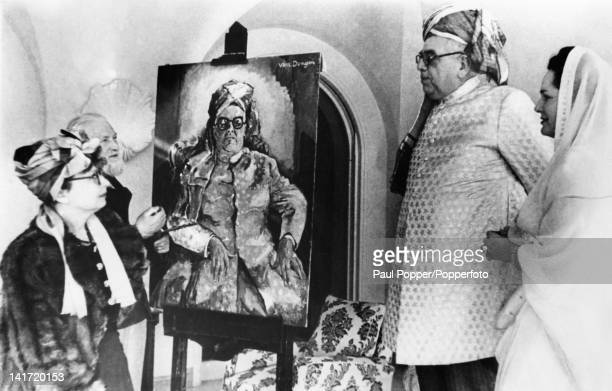 Aga Khan III leader of the Shia Ismaili Muslims is interviewed by a French reporter whilst posing for a portrait by artist Kees Van Dongen at the...
