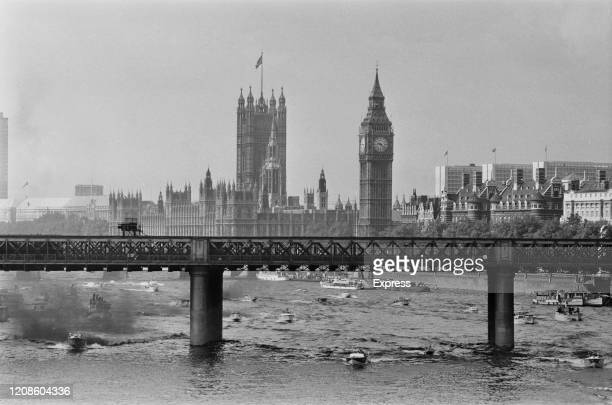 Against a backdrop of the Palace of Westminster competitors in the 1972 London to Monte Carlo Power Boat Race speed along the River Thames beneath...