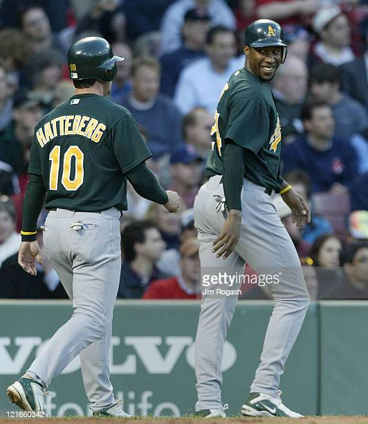Against Boston Red Sox Oakland Athletics' Scott Hatteberg and Jermaine Dye react after scoring two runs Thursday May 27 2004 The Red Sox lost 152 at...