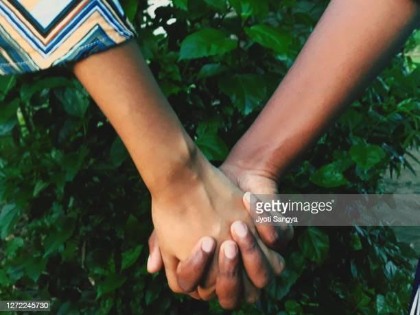 against racism - soziale gerechtigkeit stock-fotos und bilder