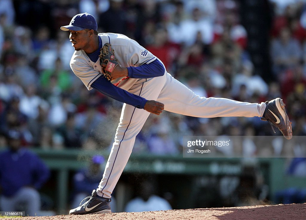 Against the Boston Red Sox, Los Angeles Dodgers relief pitcher Guillermo Mota throws at Fenway Park in Massachusetts on Saturday, June 12, 2004.
