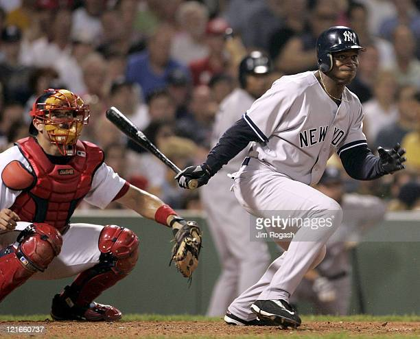 Against the Boston Red Sox New York Yankees' Kenny Lofton knocks in a run at Fenway Park in Boston Massachuesetts on July 23 2004 The Yankees won 87