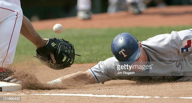 Against the Boston Red Sox Texas Rangers base runner Layne Nix scrambles back to first safely The Rangers beat the Red Sox 65 at Fenway Park in...