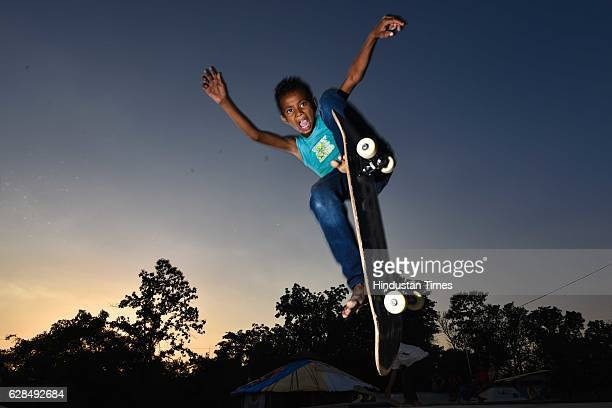 Against the fading light of the evening sky, Ramkesh, age 10, squeezes in one final jump for the camera at Skating Park, popularly known as Janwaar...
