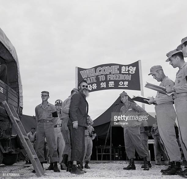 Against the most significant backdrop of 1953 the welcome sign at Panmunjom one of the first American POW's to be repatriated arrives early in August...