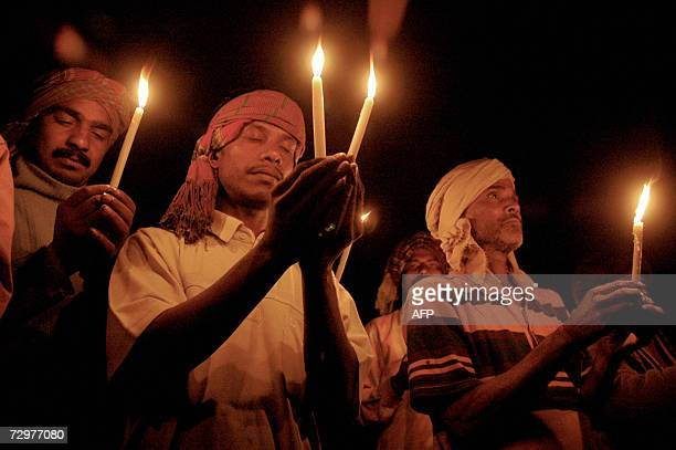 Indian Bihari laborers pay homage by lighting candles in Agartala capital of Indias northeastern state Tripura 11 January 2007 in tribute to the...