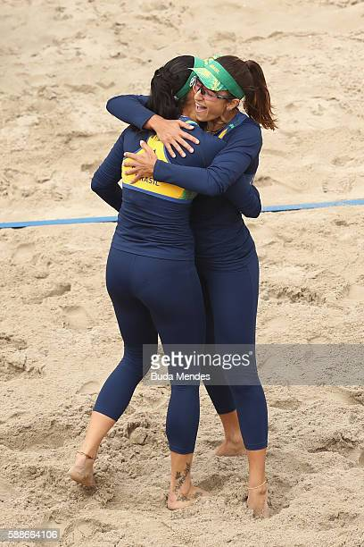 Agatha Bednarczuk and Barbara Seixas de Freitas of Brazil celebrate a point during the Women's Round of 16 match against Fan Wang and Yuan Yue of...