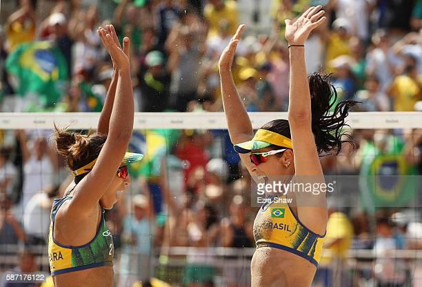 Agatha Bednarczuk and Barbara Seixas de Freitas of Brazil celebrate during the Women's Beach Volleyball preliminary round Pool B match against Ana...