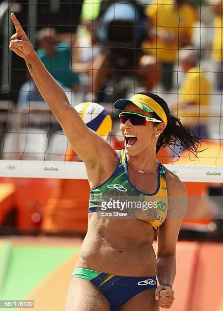 Agatha Bednarczuk of Brazil celebrates during the Women's Beach Volleyball preliminary round Pool B match against Ana Gallay and Georgina Klug of...