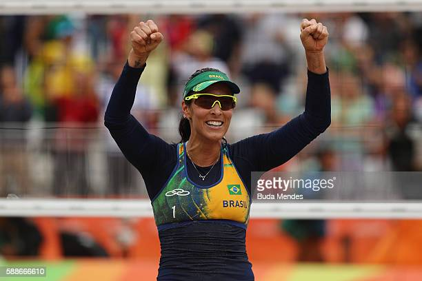 Agatha Bednarczuk of Brazil celebrates victory during the Women's Round of 16 match against Fan Wang and Yuan Yue of China on Day 7 of the Rio 2016...