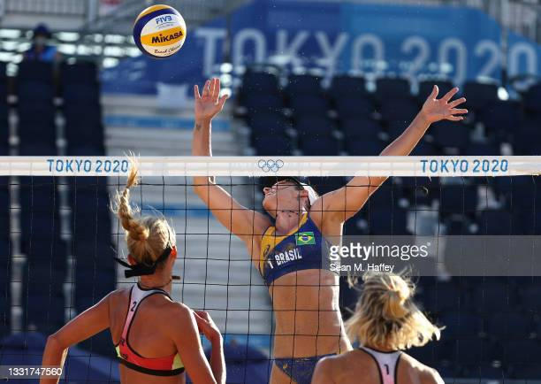 Agatha Bednarczuk of Team Brazil competes against Margareta Kozuch and Laura Ludwig of Team Germany during the Women's Round of 16 beach volleyball...