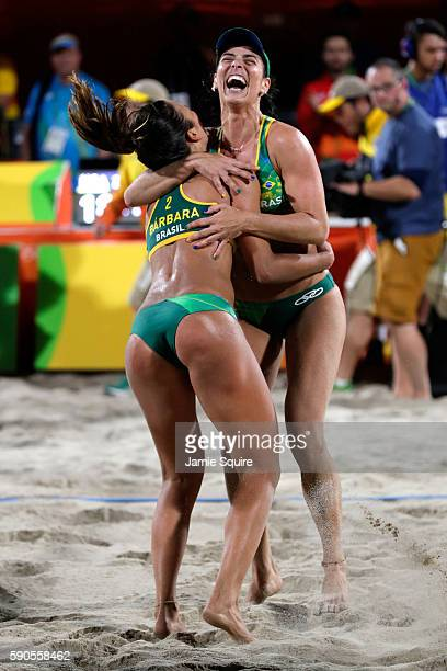 Agatha Bednarczuk Rippel and Barbara Seixas De Freitas of Brazil celebrate winning the beach volleyball Women's Semi final against Kerri Walsh...