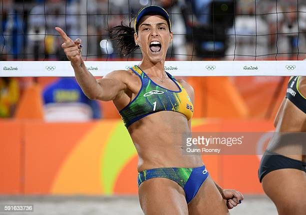 Agatha Bednarczuk Rippel of Brazil celebrates a point during the Beach Volleyball Women's Gold medal match against Laura Ludwig of Germany and Kira...