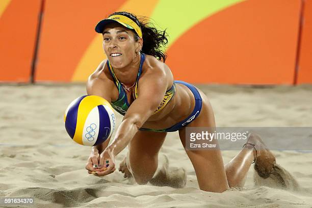 Agatha Bednarczuk Rippel of Brazil plays a shot during the Beach Volleyball Women's Gold medal match against Laura Ludwig of Germany and Kira...