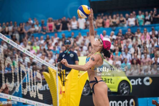 Agatha Bednarczuk Rippel of Brazil spikes the ball during the gold medal match against Laura Ludwig and Kira Walkenhorst of Germany during Day 4 of...