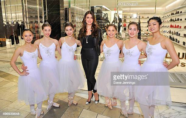 Agatha Relota Luczo poses with the Silicon Valley Ballet at the Cocktails Couture luxury event at Westfield Valley Fair on November 12 2015 in Santa...