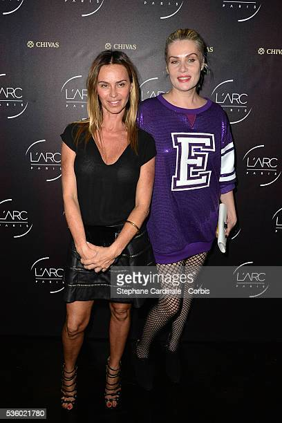 Agathe de La Fontaine and Emmanuelle Seigner attend the Arc Opening Party on October 3 2014 in Paris France