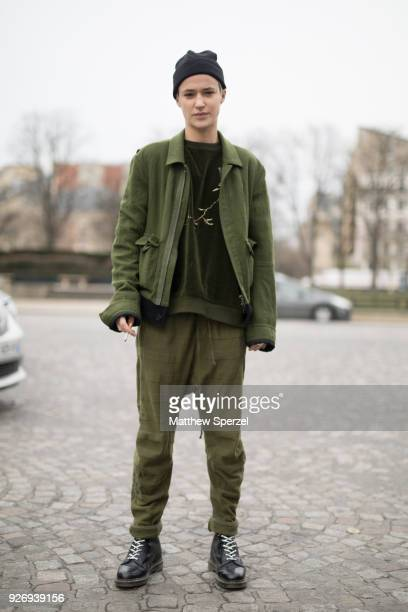 Agathe Mougin is seen on the street attending Haider Ackermann during Paris Women's Fashion Week A/W 2018 wearing an army green outfit with black...