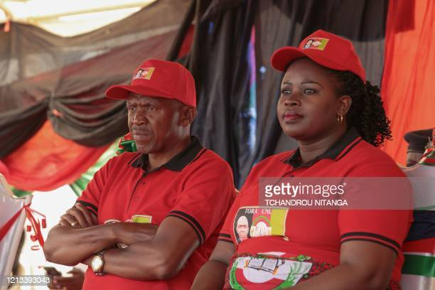 Agathon Rwasa presidential candidate of the main opposition party the National Congress for Liberty and his wife Annociate Haberisoni look on during...