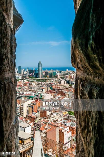 agbar tower and barcelona buildings seen from sagrada familia - familia stock pictures, royalty-free photos & images