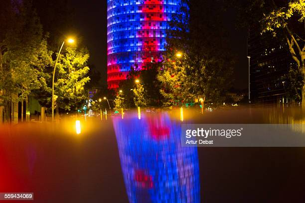 Agbar tower illuminated at night with reflection
