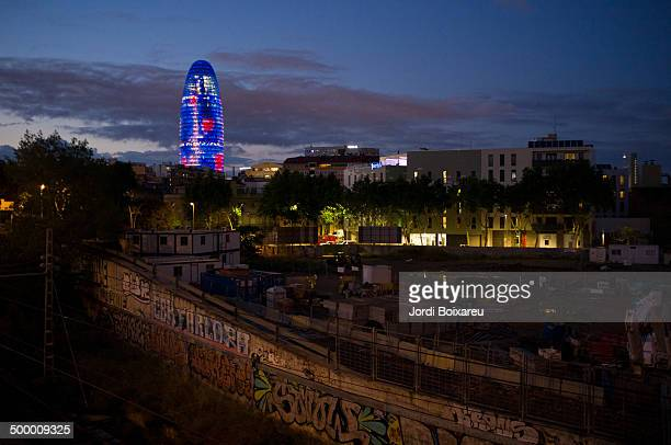 CONTENT] Agbar Tower view in the Poblenou district of Barcelona at sunset