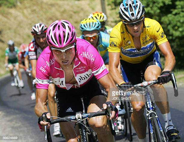FILES Picture taken 16 July 2005 shows German Jan Ullrich riding in front of yellow jersey US Lance Armstrong during the 14th stage of the 92nd Tour...