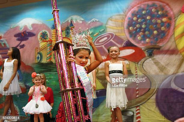 MB age 8 being crowned as the Ultimate Glitz winner at the Big Top Pageant at the Holiday Inn in Harrisburg Pennsylvania on August 12 2012 Mary has...