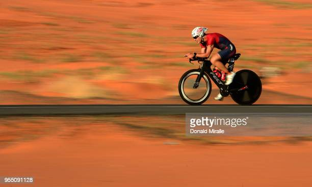 Age Group Triathlete Giovanni Blanco of Italy bikes through the sand dunes during the IRONMAN 70.3 St George Utah on May 5, 2018 in St George, Utah.
