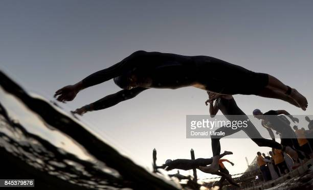 Age group triathletes enter the water during the Men's IRONMAN 703 St World Championships on September 10 2017 in Chattanooga Tennessee