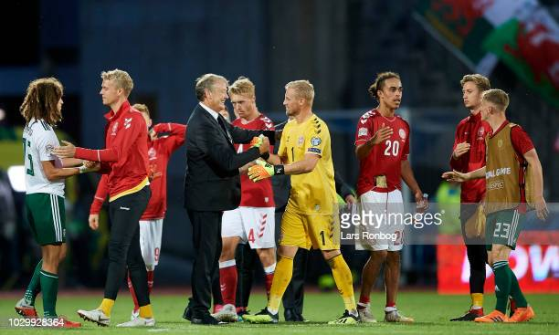 Age Hareide head coach of Denmark and Goalkeeper Kasper Schmeichel of Denmark celebrate after the UEFA Nations League match between Denmark and Wales...
