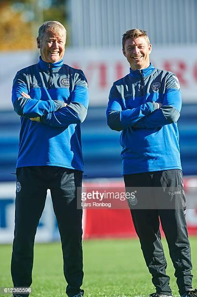 Age Hareide head coach of Denmark and Jon Dahl Thomasson assistant coach looks on during speaks to his players during speaks the Denmark training...