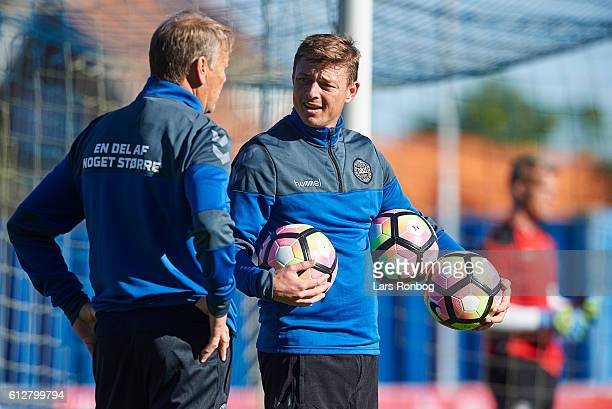 Age Hareide head coach of Denmark and Jon Dahl Thomasson assistant coach looks on during the Denmark training session at Helsingor Stadion on October...
