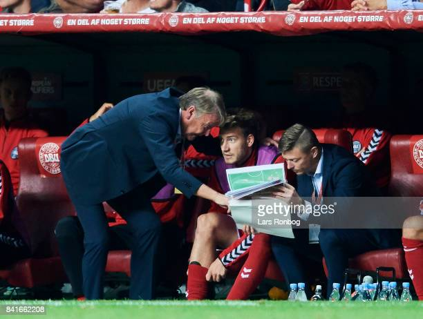 Age Hareide head coach of Denmark and Jon Dahl Tomasson assistant coach of Denmark speaks to Nicklas Bendtner of Denmark during the FIFA World Cup...
