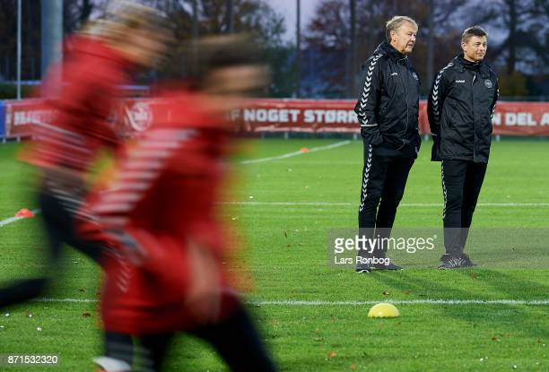 Age Hareide head coach of Denmark and Jon Dahl Tomasson assistant coach of Denmark watching the players during the Denmark training session at...