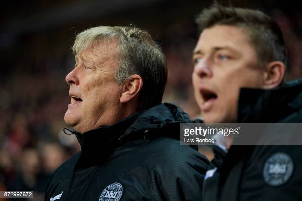 Age Hareide head coach of Denmark and Jon Dahl Tomasson assistant coach of Denmark singing during the national anthem prior to the FIFA 2018 World...