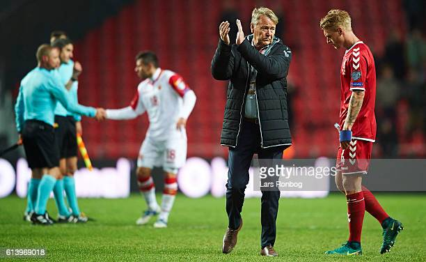 Age Hareide head coach of Denmark and Simon Kjar of Denmark look dejected after the FIFA World Cup 2018 european qualifier match between Denmark and...