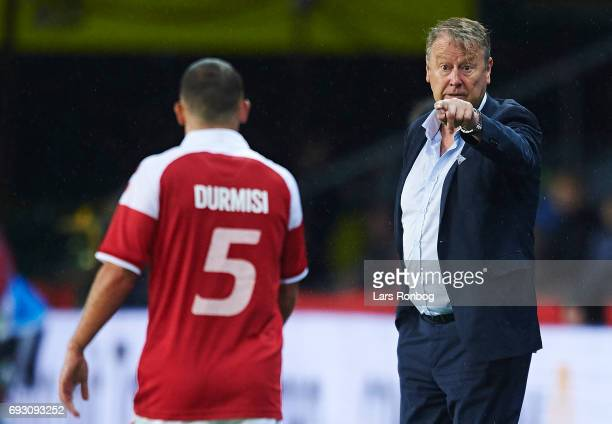 Age Hareide head coach of Denmark gestures against Riza Durmisi of Denmark during the international friendly match between Denmark and Germany at...